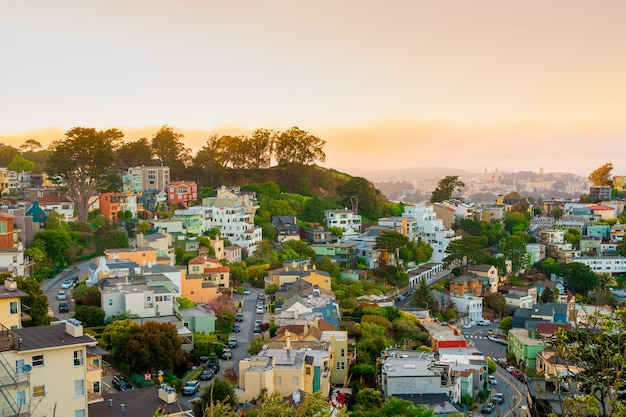 A picturesque panorama of the city of san francisco at a bright beautiful sunset from twin peaks