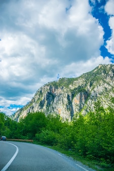 A picturesque road passes through the mountains and canyons in montenegro.