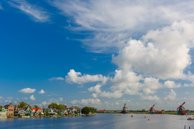 Picturesque rural landscape with windmills in zaanse schans close to river, holland, netherlands
