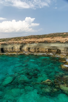 Picturesque sea caves are located on the mediterranean coast.
