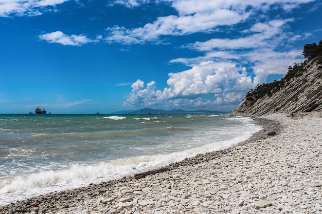 Picturesque stone wild beach at the foot of the rocks in the vicinity of the resort of gelendzhik