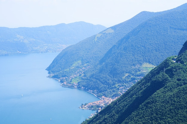 Picturesque summer landscape aerial view of lake iseo forested mountains various villages scattered