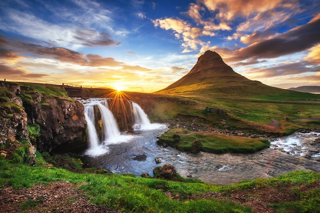 The picturesque sunset over landscapes and waterfalls.