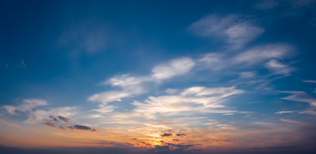 Picturesque sunset sky with clouds illuminated with dramatic sunlight. natural background of the sky.