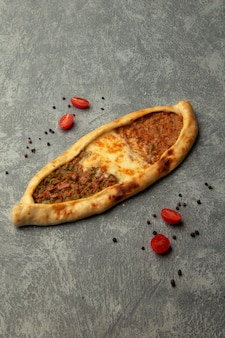 Pide with chopped meat and melted cheese