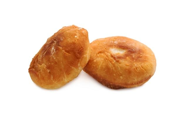 パイ、白で隔離。伝統的なロシアのパテ。ピロシキ。