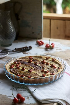 Pie stuffed with vegetables, cottage cheese and cream. rustic style.