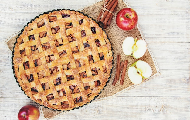 Pie with apples and cinnamon.