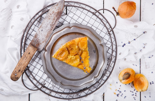 Pie with apricots.homemade cakes,with lavender on a white background.