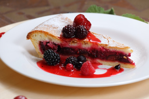 Pie with prunes and forest berries