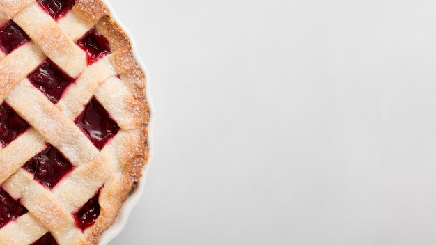 Pie with strawberry jam and copy space