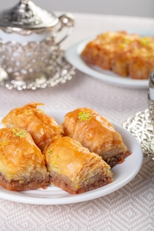 A piece of baklawa on a  plate on a table