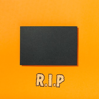 Piece of black paper with r.i.p inscription below