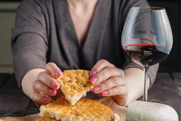 Piece of bread in woman hands