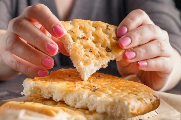 Piece of bread in woman's hands