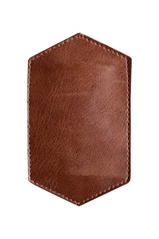 Piece of brown leather with respite isolated on white background.
