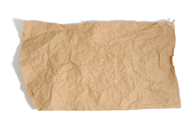 Piece of brown parchment paper with torn edges isolated on white background, element for designer