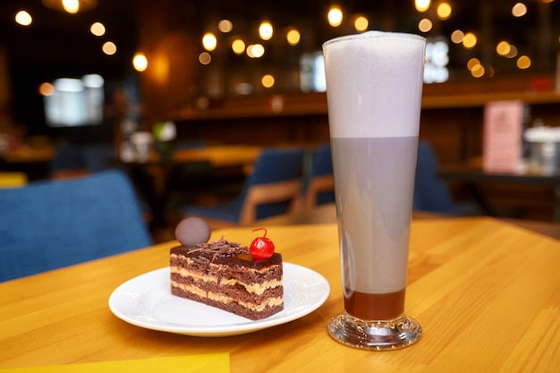 Piece of cake and drink on table in cafe