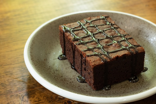 Piece of chocolate brownie in dish