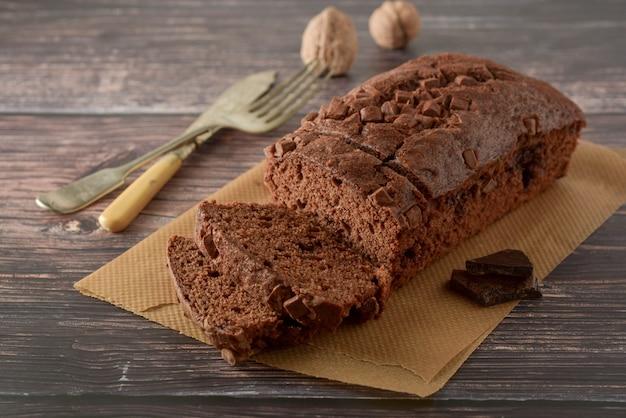 Piece of chocolate cake, fudge or pound cake.