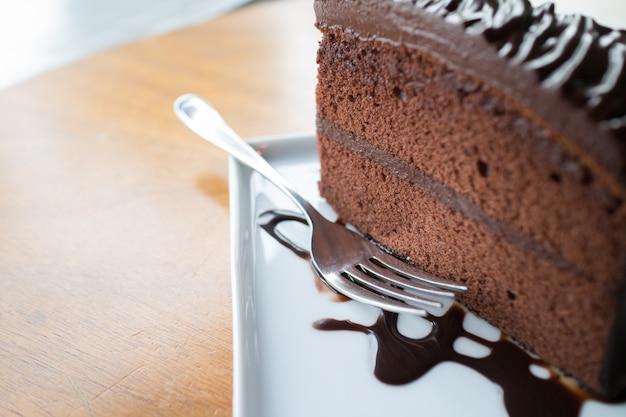Piece of chocolate cake with warm chocolate syrup