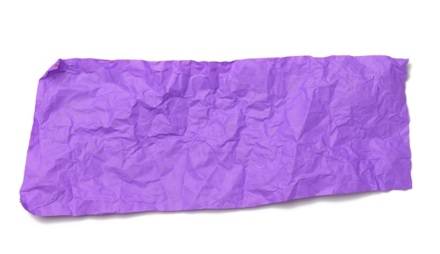 Piece of crumpled purple gift wrapping paper isolated on white background