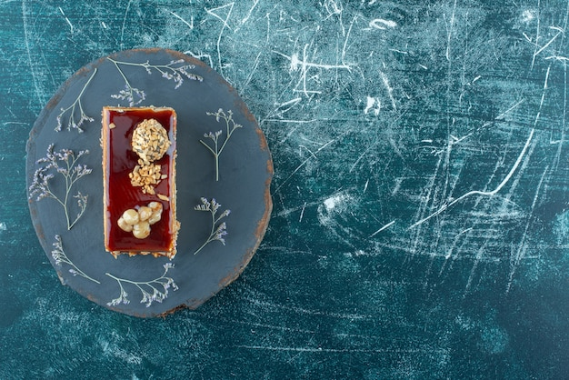 A piece of delicious cake with walnut on a plate . high quality photo