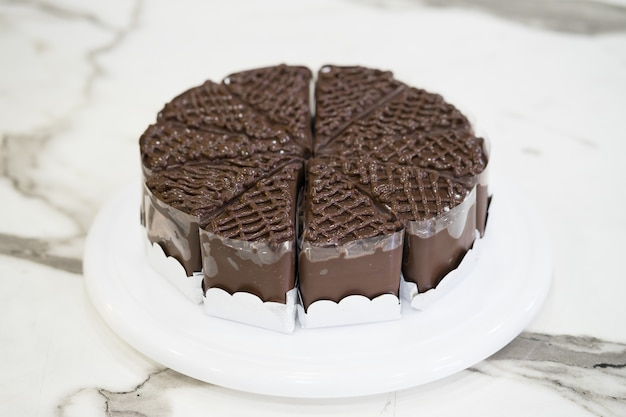 Piece of delicious chocolate cake on plate