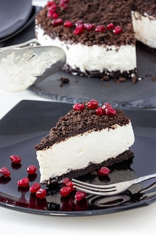 Piece of delicious vanilla chocolate cheesecake.