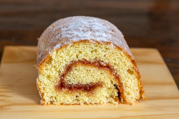 Piece of guava roulade on wooden table