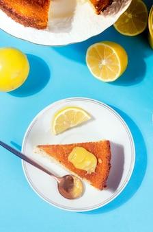Piece of homemade freshly baked sponge cake on plate