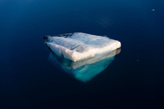 Piece of ice in clean water. iceberg. underwater part.