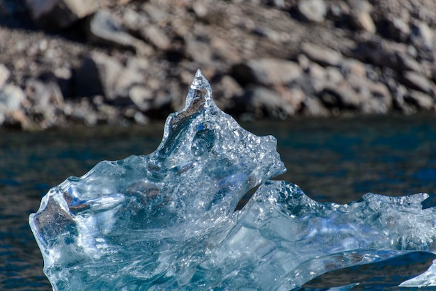 Piece of ice in clean water. iceberg.