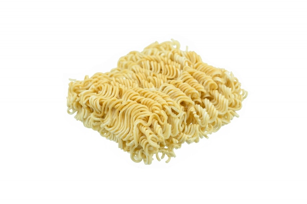 Piece of instant noodles on paper isolated white background