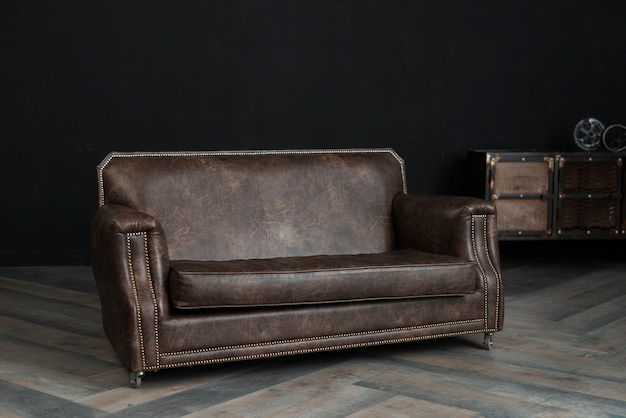 Piece of leather furniture in dark room