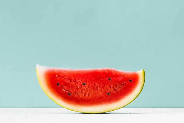 Piece of red watermelon on table