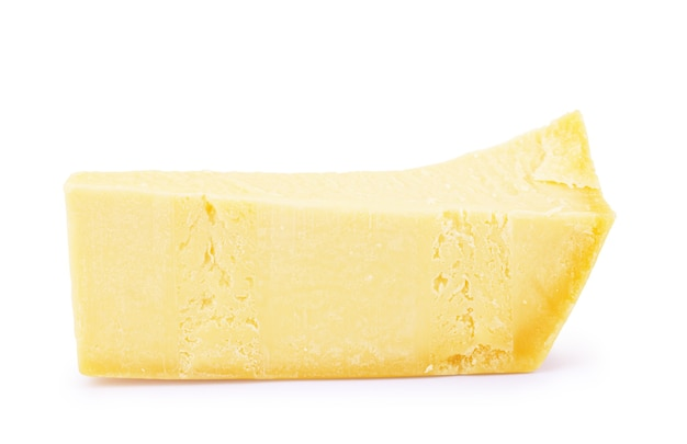 Piece and slices of cheese isolated on white background
