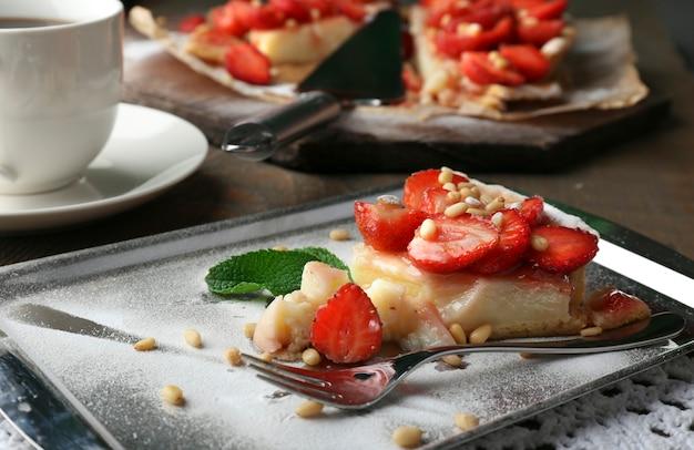 Piece of strawberry tart on tray