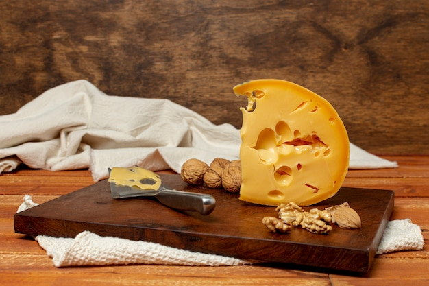 Piece of tasty cheese on a board