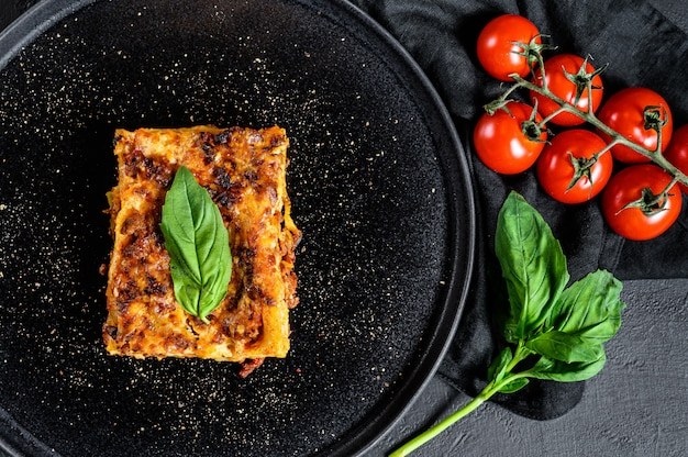 Piece of tasty hot lasagna. traditional italian food. top view