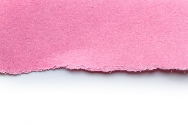A piece of torn pink paper. note paper strips for text or message. scrap paper.