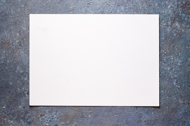 Piece of with blank white paper sheet background.