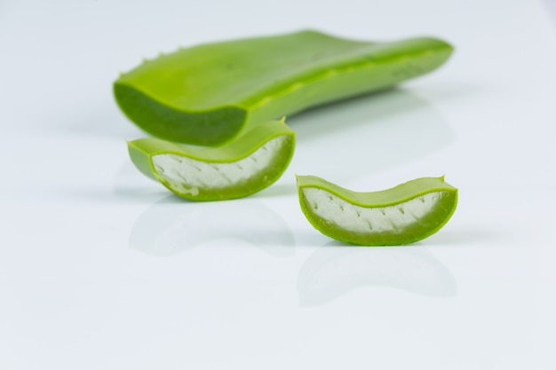 Pieces of aloe vera on whitle wall.