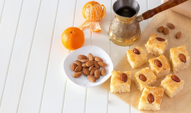 Pieces basbousa traditional arabic semolina cake with almond.