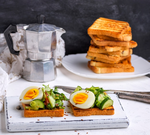 Pieces of bread from white wheat flour with boiled egg