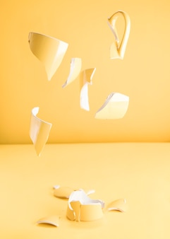 Pieces of a broken yellow mug