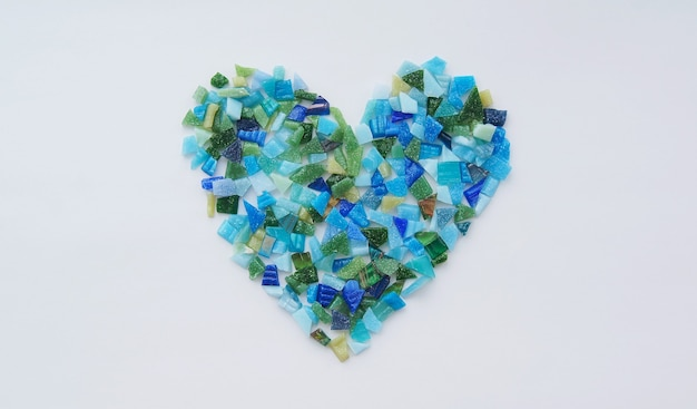 Pieces of ceramic mosaic in the shape of a heart. the concept of love and valentine's day