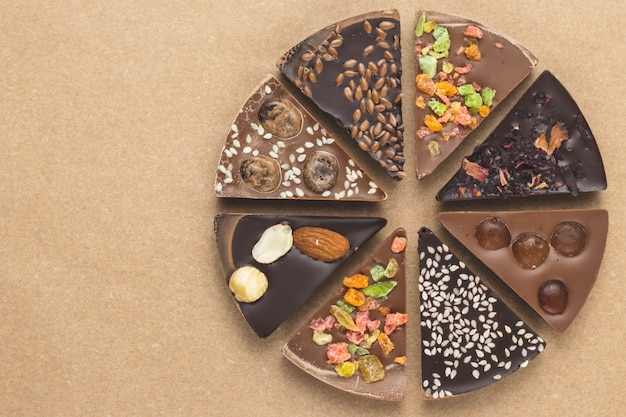 Pieces of chocolate on brown craft paper.