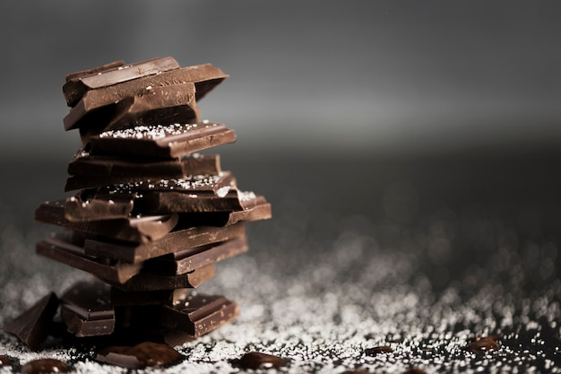 Pieces of chocolate in a pile and copy space