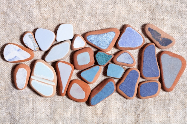 Pieces of colorful tiles polished by the sea